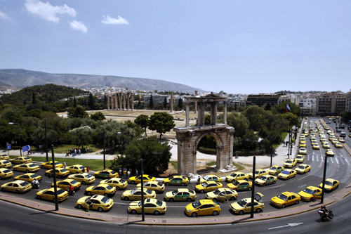 Stationary taxis are seen in front of Athens' Hadrian Gate during a protest in Athens.