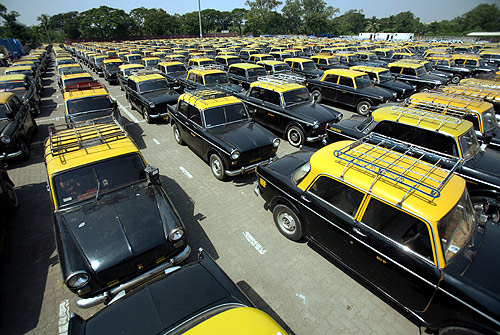 Taxi cabs are seen parked during a one-day strike in Mumbai.