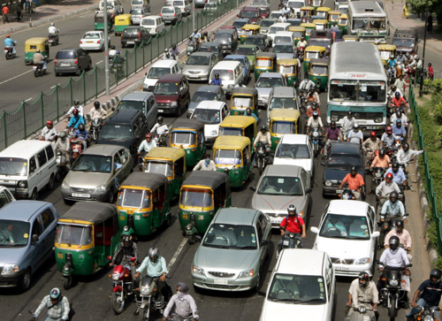 Traffic moves at a slow pace on a street of New Delhi.