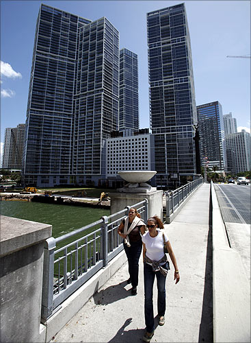 People walk past the Icon Brickell condo, billionaire Jorge Perez's latest project, in downtown Miami, Florida.