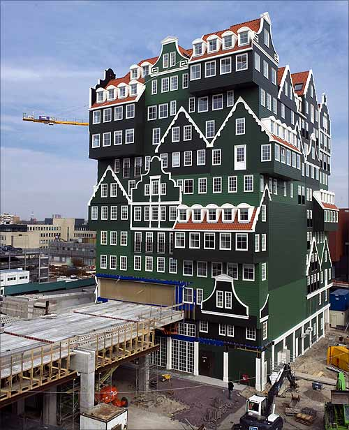 Construction work continues on a hotel made to look like seventy Zaanse houses stacked together in the centre of Zaandam, north of Amsterdam.