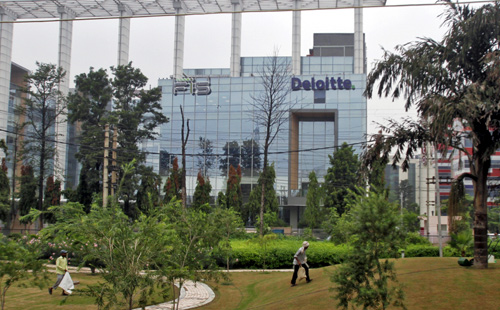 Deloitte Company logo is seen on a commercial tower at Gurgaon, on the outskirts of New Delhi.