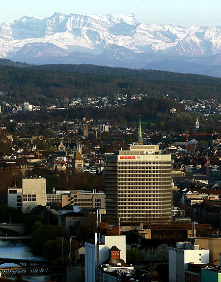 A general view shows the headquarters of Swiss Migros group in front of the city of Zurich and the eastern Swiss Alps.