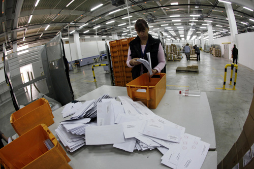 A worker sorts mail in Bulgaria's main postal logistic centre in Sofia.