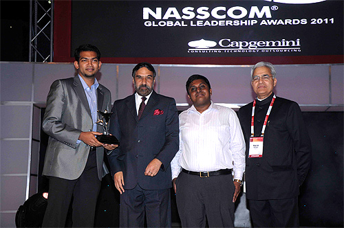 Sanjay Vijayakumar, Co-founder and Chief Executive Officer, MobME receives the Nasscom award from Anand Sharma,  Minister for Commerce and Industries, former Nasscom chairman, Harsh Manglik, Vivek Francis,  MobME Co-founder MobME.