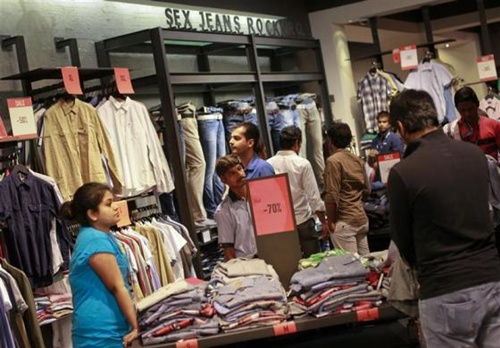 People shop for clothes at a store during a seasonal sale inside a shopping mall in Mumbai.