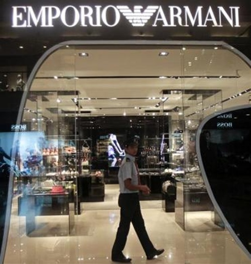 A security guard walks inside a Giorgio Armani showroom in a shopping mall in Mumbai.