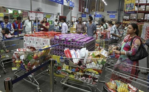 Customers wait to pay for their goods at a Best Price Modern Wholesale store, a joint venture of Wal-Mart Stores Inc and Bharti Enterprises, at Zirakpur in Punjab.
