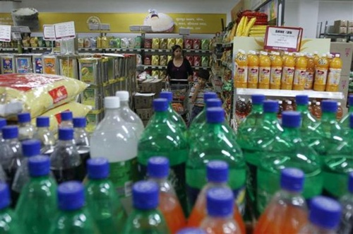 A woman shops inside a food superstore in Ahmedabad.