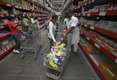 Customers shop at a Best Price Modern Wholesale store, a joint venture of Wal-Mart Stores Inc and Bharti Enterprises, at Zirakpur in Punjab.
