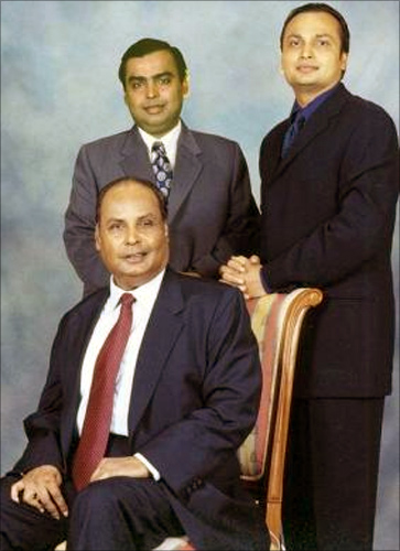 Mukesh Ambani, Anil Ambani pose with their father Dhirubhai Ambani in Mumbai in this November 2000 file photo.
