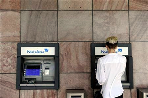 A customer makes a withdrawal from a Nordea automatic teller machine in Stockholm.