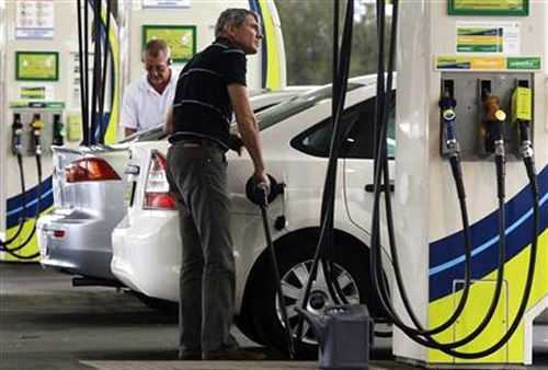 A man refuels his car at a petrol station in Sydney.