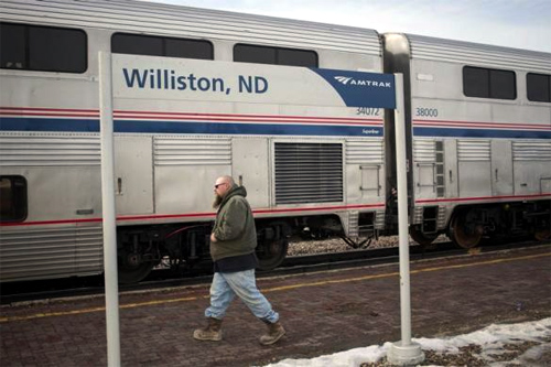 A man walks by the Amtrak train station in Williston, North Dakota.
