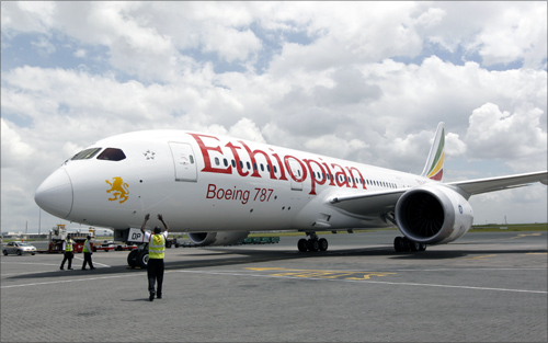 A cabin crew member (L) walks inside an Ethiopian Airlines' 787 Dreamliner after it arrived at the Jomo Kenyatta international airport in Kenya's capital Nairobi.
