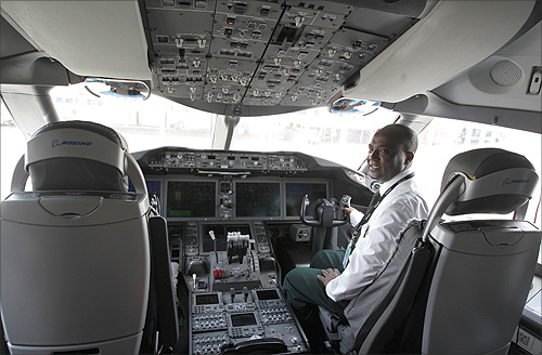Aviation engineers inspect an Ethiopian Airlines' 787 Dreamliner after it arrived at the Jomo Kenyatta international airport in Kenya's capital Nairobi.