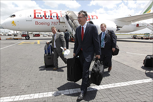 Randy Tinseth, vice president of marketing for Boeing commercial airplanes (front), walks from an Ethiopian Airlines' 787 Dreamliner after it arrived at the Jomo Kenyatta international airport in Kenya's capital Nairobi.