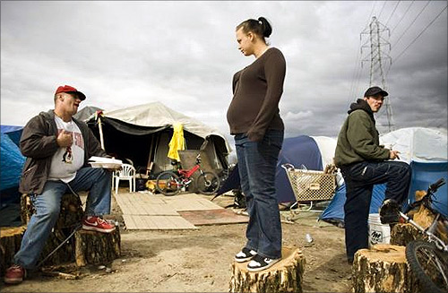 Rob Bennett (L), Kami Ballard (C), and James Meece at a homeless tent city in Sacramento, California.