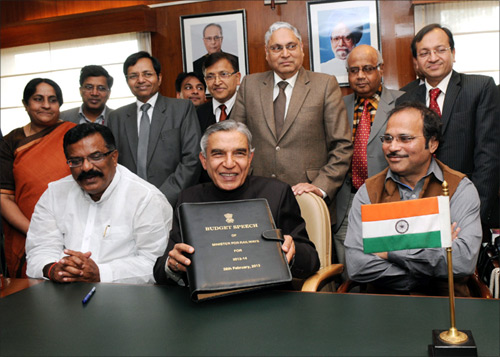 Union Railway Minister Pawan Kumar Bansal with Ministers of State for Railways, K.J. Surya Prakash Reddy and Adhir Ranjan Chowdhury and the Chairman, Railway Board, Vinay Mittal.