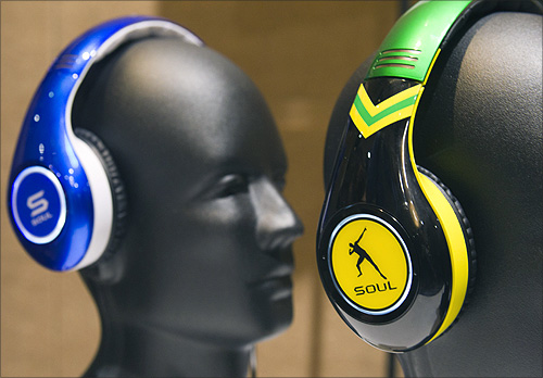 Tim Tebow (L) and Usain Bolt-themed Soul SL300 noise canceling headphones displayed at the opening press event of the Consumer Electronics Show (CES) in Las Vegas.