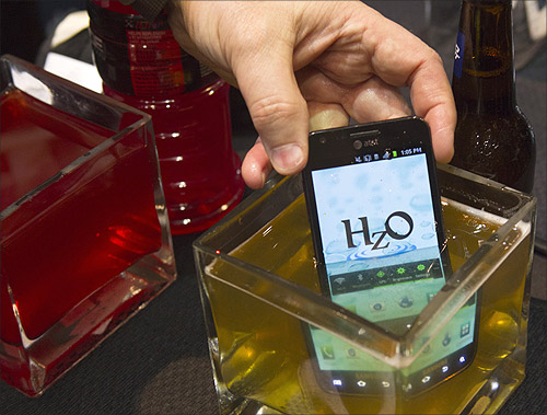 A smart phone with HzO Waterblock technology is dipped in beer at the opening press event of the Consumer Electronics Show (CES) in Las Vegas.