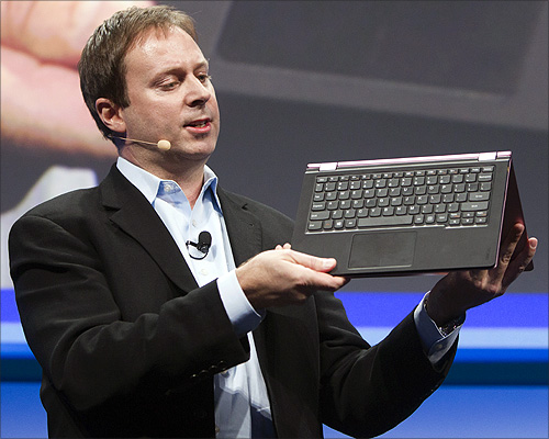 Kirk Skaugen, Intel's vice president of PC client group, converts a Lenovo Yoga Ultrabook into a tablet, at an Intel news conference during the Consumer Electronics Show (CES) in Las Vegas.