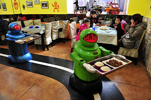 Robots deliver dishes to customers at a Robot Restaurant in Harbin, Heilongjiang province.