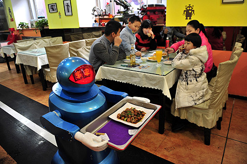 A restaurant where robots cook and serve food