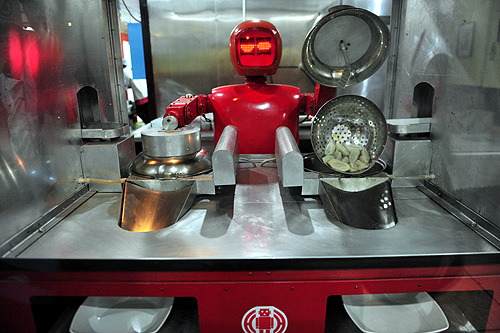 A robot that specialises in cooking, prepares jiaozi, or Chinese dumplings, at a Robot Restaurant in Harbin, Heilongjiang province.