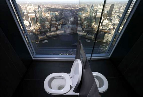 A toilet overlooking the financial district is seen in a restroom of The View gallery at the Shard, western Europe's tallest building, in London.