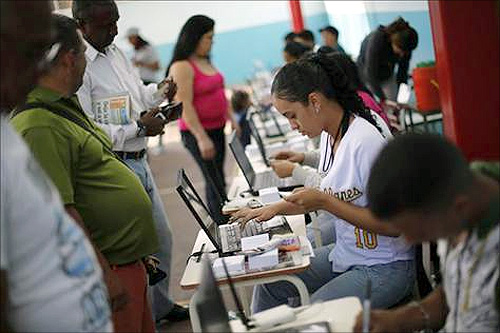 Venezuelans line up to cast their votes during a governors election in Caracas.