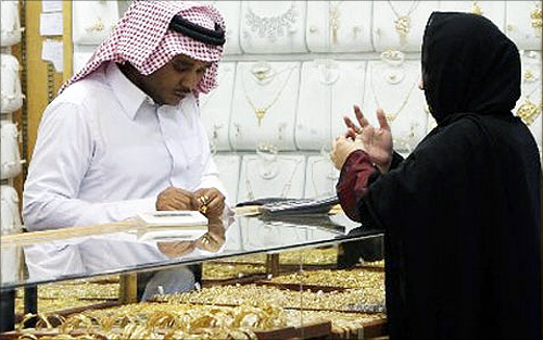 A  salesman shows a customer gold rings at a jewellery shop in Riyadh.