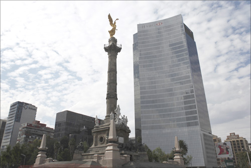 The Angel of Independence is seen near a building of HSBC in Mexico City.