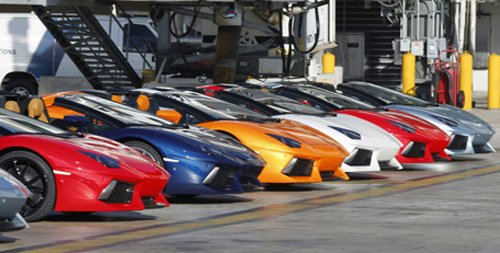Lamborghini LP 700-4 Roadsters are displayed after a high-speed demonstration.