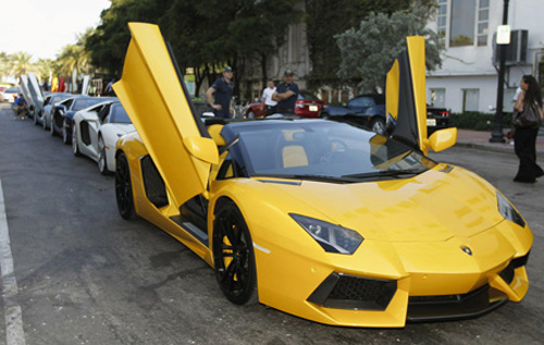 A Lamborghini Aventador LP 700-4 Roadster waits for a parade to begin before a high-speed demonstration to mark the automaker's 50th anniversary.