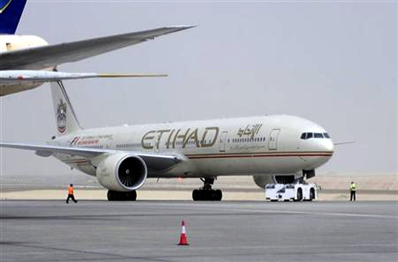 An Etihad Airways aircraft is seen at Abu Dhabi International Airport.