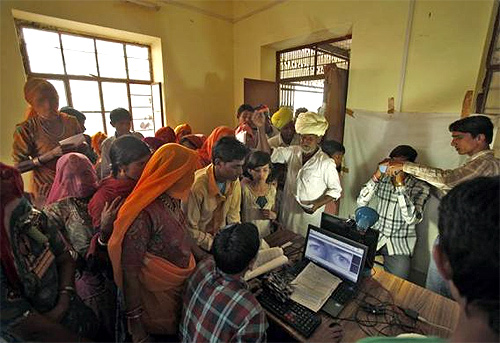 Villagers crowd inside an enrolment centre for the Unique Identification (UID) database system at Merta district in Rajasthan.