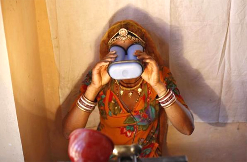 A villager goes through the process of eye scanning for Unique Identification (UID) database system at an enrolment centre at Merta district in Rajasthan.