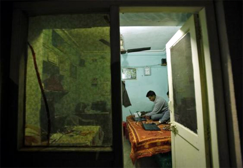 Unique Identification (UID) database system operators work inside a temporary space at Merta district in Rajasthan.