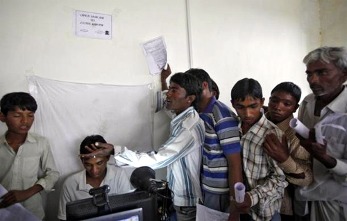 Villagers stand in a queue to get themselves enrolled for the Unique Identification (UID) database system at Merta district in Rajasthan.