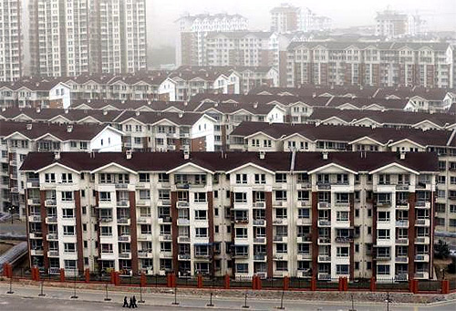New apartment buildings, where the local government built homes for former miners and farmers as part of an urbanization program, are seen in Mentougou district, suburb of Beijing.