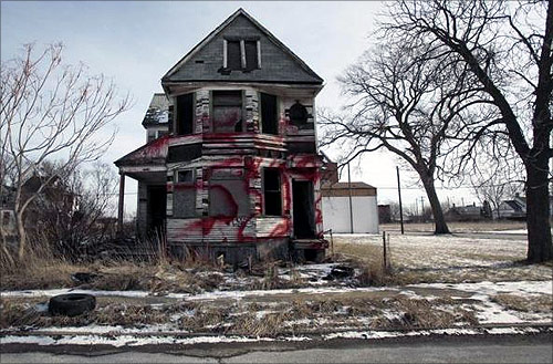 A vacant and blighted home, covered with red spray paint, sits alone in an east side neighborhood once full of homes in Detroit, Michigan.