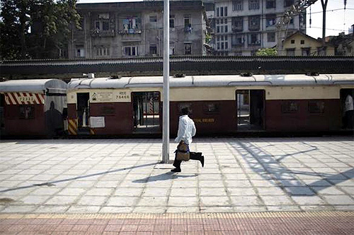 A man runs to catch a train at Dadar Railway Station in Mumbai.