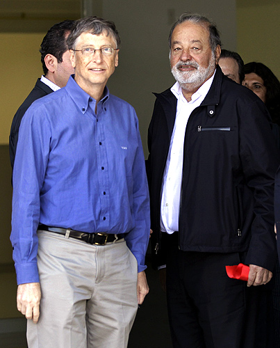 Mexican businessman Carlos Slim (R) stands with Microsoft founder and philanthropist Bill Gates after taking part in the inauguration of a new research facility at the International Maize and Wheat Improvement Center (CIMMYT) in Texcoco outside Mexico City.