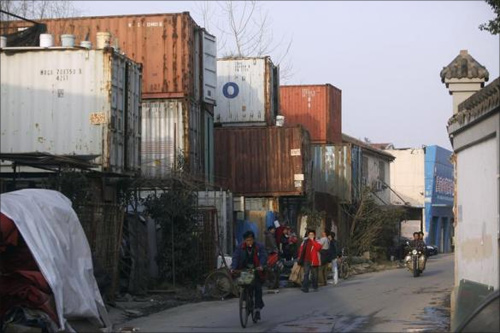 Families live in a shipping container!