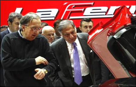 Ratan Tata and  Fiat CEO Sergio Marchionne (L) inspects the new LaFerrari hybrid car.