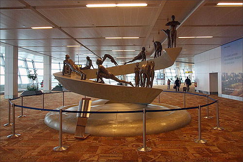 Sculpture depicting 12 asana's of the Surya Namaskar at Terminal T3 at IGIA Airport, New Delhi.