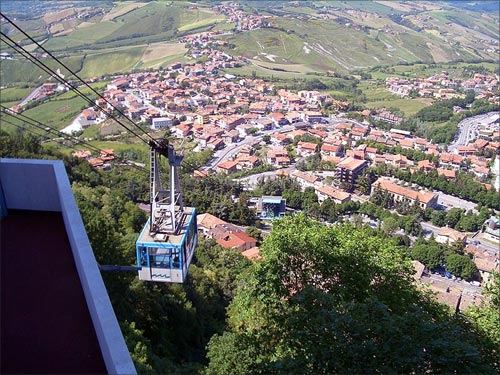Aerial tramway gondola travels between San Marino city and Borgo Maggiore.