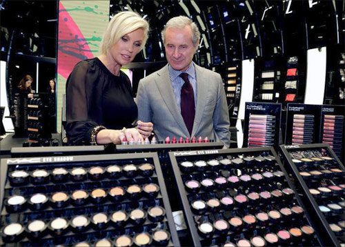 Fabrizio Freda (R), President and CEO, The Estee Lauder Companies, and Karen Buglisi (L), Global Brand President, M.A.C Cosmetics, pose in the M.A.C shop in Paris.