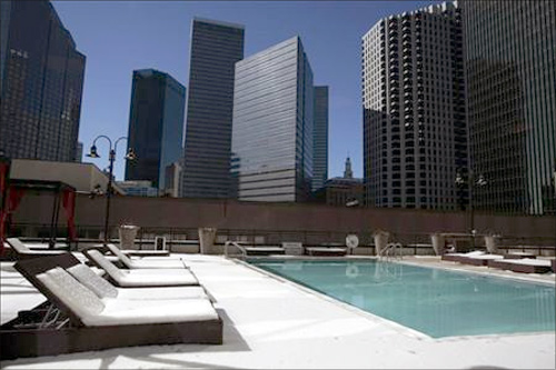 A swimming pool area is covered in snow after a storm dropped five inches of snow in downtown Dallas, Texas.
